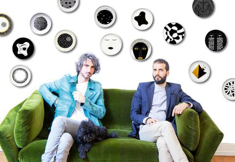 Green, Sitting, Comfort, Circle, Blazer, Living room, Beard, Suit trousers, Symbol, Couch,