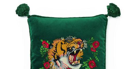 Green, Cushion, Font, Furniture, Pillow, Textile, Throw pillow, Bag, Fictional character, Coin purse,