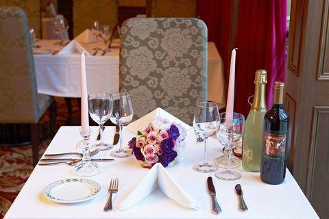 Restaurant, Champagne stemware, Table, Rehearsal dinner, Stemware, Wine glass, Room, Textile, Event, Tableware,