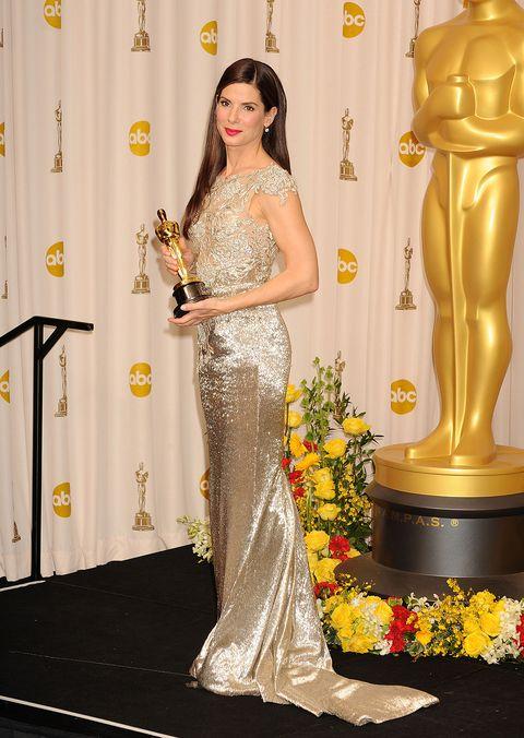Red carpet, Dress, Clothing, Carpet, Yellow, Gown, Flooring, Shoulder, Fashion model, Fashion,