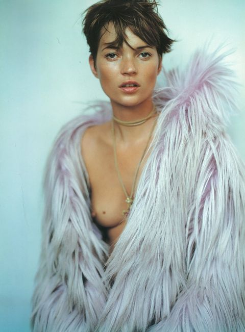 Hairstyle, Skin, Neck, Natural material, Feather, Fur, Animal product, Model, Fashion model, Body jewelry,