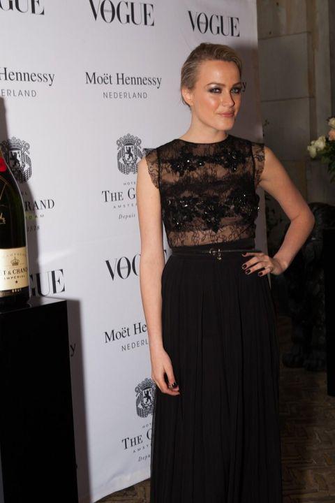 Shoulder, Bottle, Glass bottle, Joint, Dress, Wine bottle, Drink, Style, Waist, Fashion,