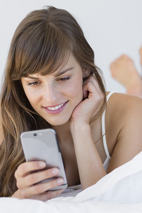 happy beautiful young woman messaging with a mobile phone