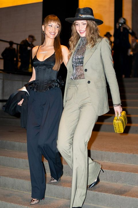 Clothing, Fashion, Fashion model, Fashion design, Fedora, Pantsuit, Suit, Hat, Event, Footwear,