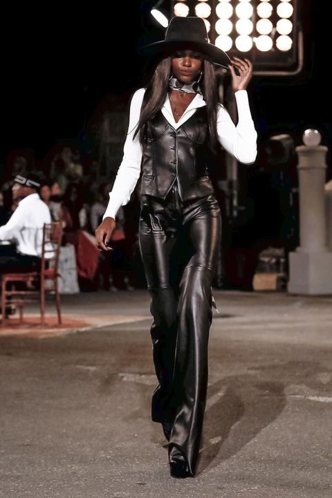 Fashion, Suit, Formal wear, Fashion model, Headgear, Hat, Leather, Performance, Tuxedo, Haute couture,