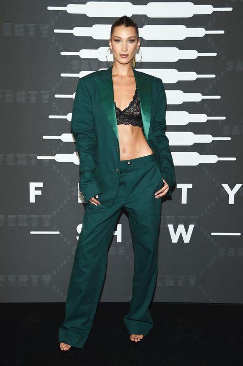 Clothing, Green, Fashion, Turquoise, Suit, Fashion design, Pantsuit, Outerwear, Fashion model, Formal wear,