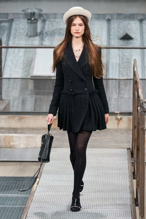Fashion model, Clothing, Fashion, Black, Street fashion, Tights, Fashion show, Little black dress, Outerwear, Leg,