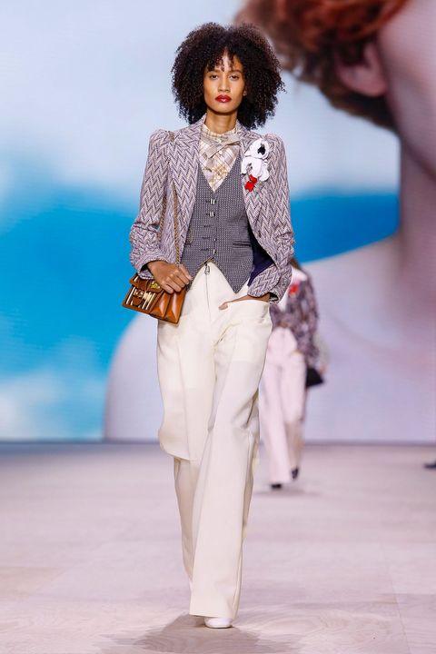Fashion model, Fashion, Runway, Fashion show, White, Clothing, Fashion design, Event, Pantsuit, Haute couture,