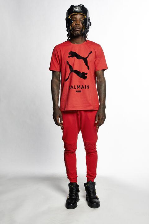 Clothing, Red, Fashion, T-shirt, Outerwear, Human, Sportswear, Sleeve, Fashion design, Trousers,