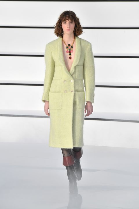 Clothing, Fashion, Fashion model, Fashion show, Runway, Outerwear, Overcoat, Haute couture, Formal wear, Neck,