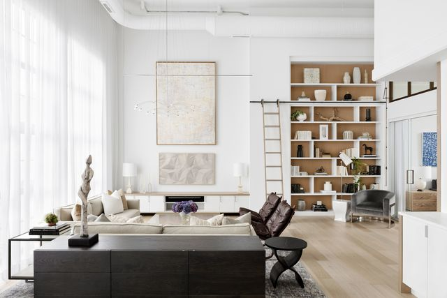open living room with floor to ceiling windows and built in shelving