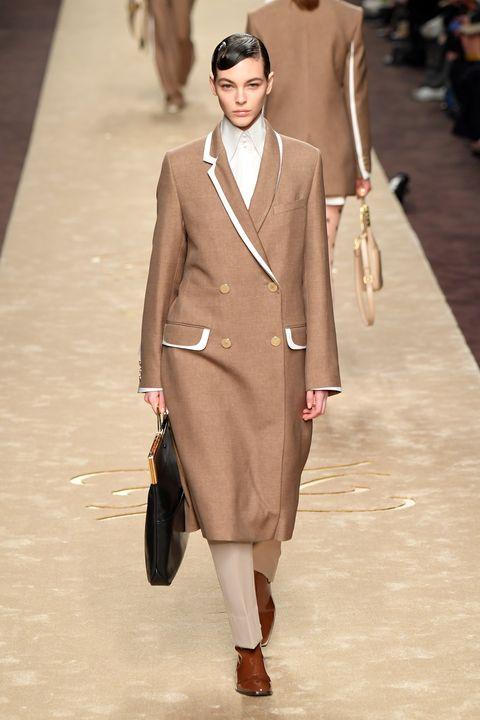 Fashion model, Fashion, Fashion show, Runway, Clothing, Suit, Beige, Brown, Human, Outerwear,