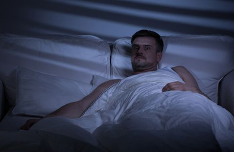 Comfort, Facial hair, Bedding, Linens, Sitting, Muscle, Beard, Bed sheet, Sleep, Pillow,