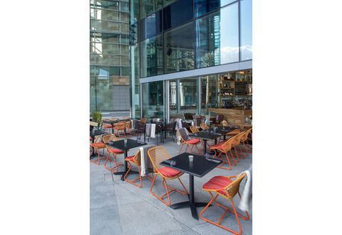 Furniture, Table, Glass, Commercial building, Chair, Outdoor furniture, Outdoor table, Headquarters, Transparent material, Restaurant,