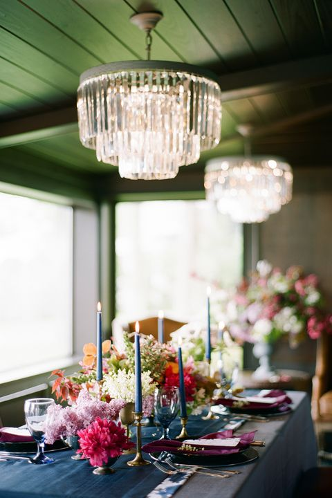 Pink, Centrepiece, Lighting, Chandelier, Yellow, Room, Table, Ceiling, Interior design, Light fixture,