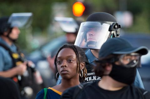 kansas city police in protective gear held the line of protesters to the sidewalk during a george floyd protest friday, may 29, 2020, at the country club plaza in kansas city  protests have been erupting all over the country after george floyd died earlier this week in police custody in minneapolis