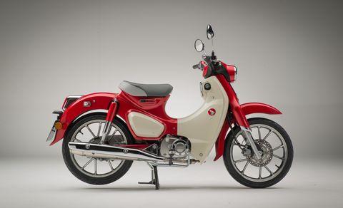 Land vehicle, Vehicle, Motorcycle, Red, Car, Motor vehicle, Mode of transport, Automotive design, Moped, Spoke,