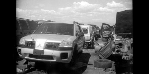 faux mitsubishi camera shoots real mitsubishis in the junkyard