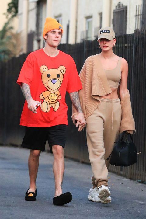 Street fashion, Fashion, Shoulder, Footwear, T-shirt, Leg, Shoe, Sunglasses, Eyewear, Fawn,