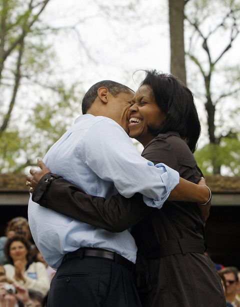 democratic presidential candidate us senator barack obama hugs his wife michelle while meeting families during a picnic at a park in noblesville, indiana, may 03, 2008  afp photoemmanuel dunand photo credit should read emmanuel dunandafp via getty images