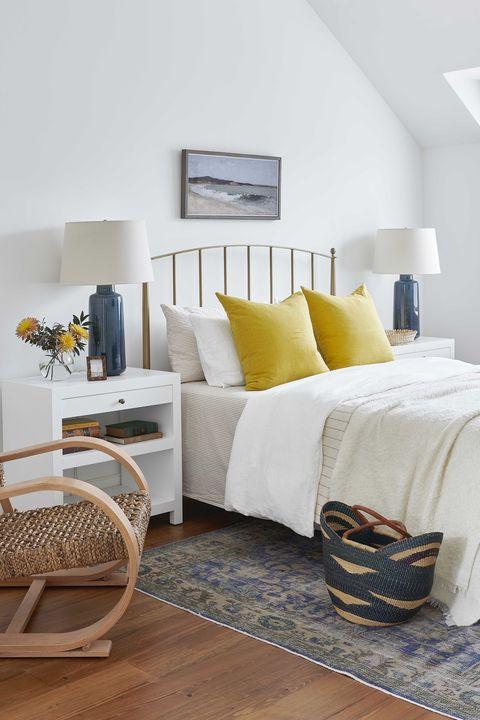 bedroom, white linen, gold headboard, yellow cushions, chair
