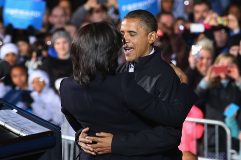 des moines, ia   november 05  us president barack obama embraces first lady michelle obama during his last rally the night before the general election november 5, 2012 in des moines, iowa the rally was held just outside obamas first headquarters from the 2008 campaign, where his first march to the white house started obama and his opponent, republican presidential nominee and former massachusetts gov mitt romney are stumping from one swing state to the next in a last minute rush to persuade undecided voters  photo by chip somodevillagetty images