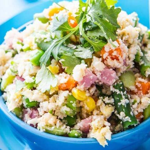 Crock Pot Cauliflower Rice Call a time out with all that takeout , especially when making this lighter, brighter, and veggie-packed version of your usual order is so very easy. GET THE RECIPE Per serving: 172 calories, 15 g fat (2 g saturated), 22 g carbs, 6 g sugar, 405 mg sodium, 8 g fiber, 13 g protein