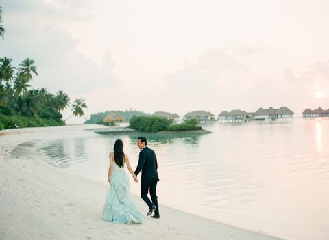 Body of water, Dress, Photograph, Coat, Bride, Suit, Wedding dress, Bank, People in nature, Interaction,