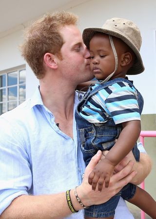 62 photos of prince harry with kids that prove he was meant to be a dad 62 photos of prince harry with kids
