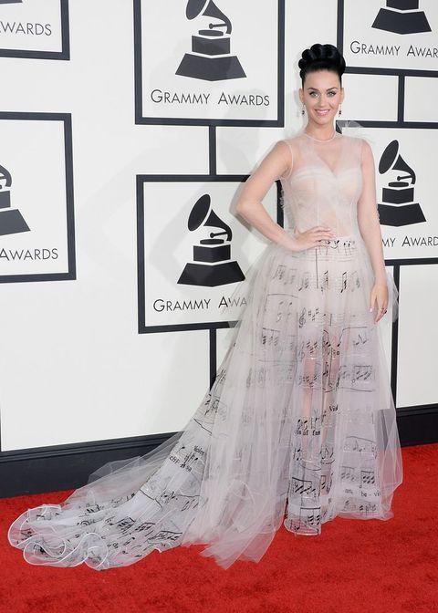 Red carpet, Dress, Clothing, Carpet, Fashion model, Gown, Flooring, Fashion, Shoulder, Haute couture,