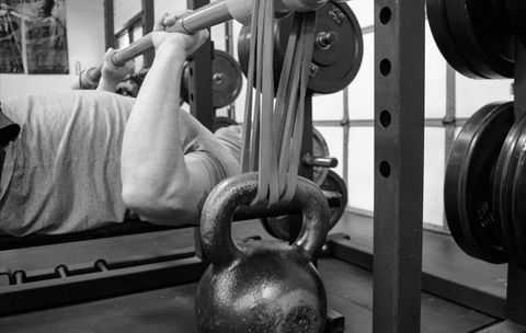 This Simple Trick Makes a Barbell Work Your Core 85 Percent Harder