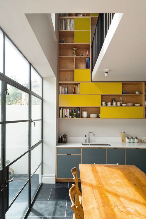 uncommon project's statement yellow kitchen cabinetry