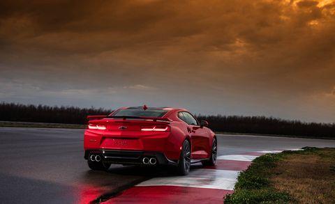 Land vehicle, Vehicle, Car, Automotive design, Red, Luxury vehicle, Sky, Performance car, Personal luxury car, Mid-size car,