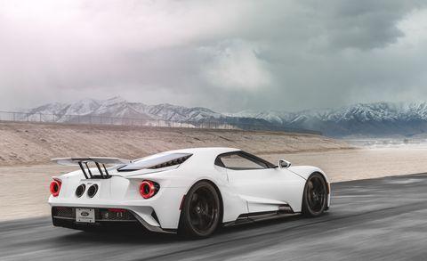 Land vehicle, Vehicle, Car, White, Automotive design, Supercar, Sports car, Coupé, Performance car, Race car,