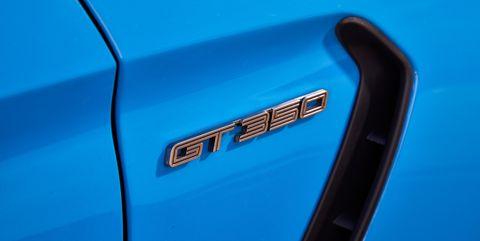 Blue, Vehicle, Car, Electric blue, Hood, Vehicle door, Emblem, Muscle car,