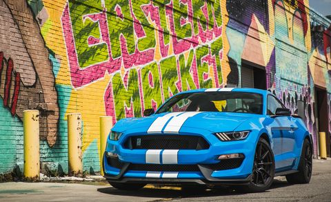 Land vehicle, Car, Vehicle, Automotive design, Coupé, Shelby mustang, Performance car, Yellow, Muscle car, Infrastructure,