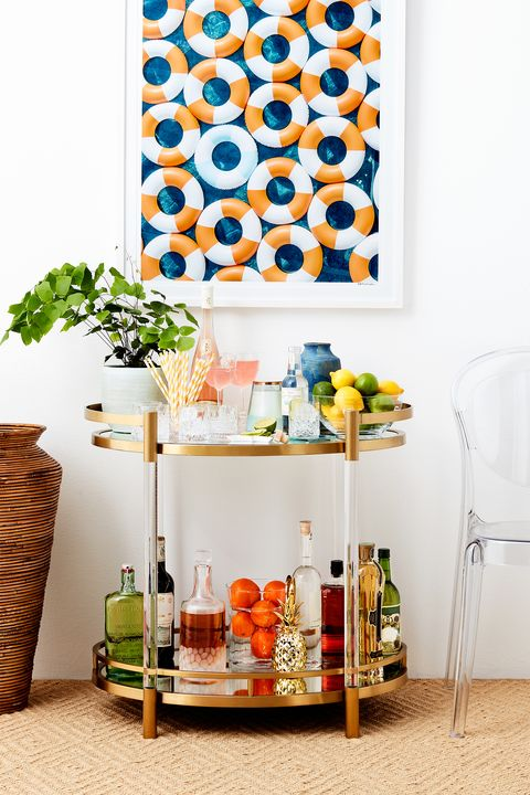 Furniture, Shelf, Orange, Room, Wall, Table, Interior design, Design, Textile, Plant,