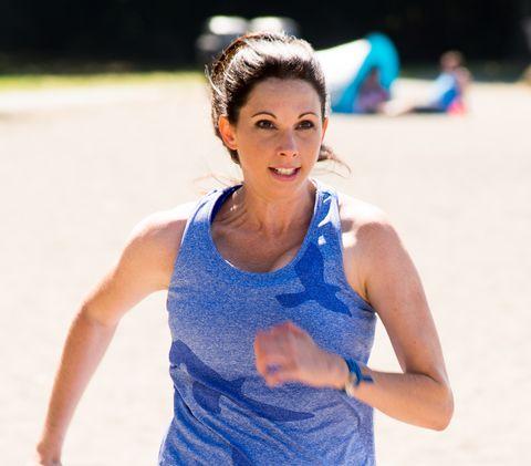 Blue, Cobalt blue, Electric blue, Recreation, Leisure, Running, Photography, Neck, Exercise, Sleeveless shirt,