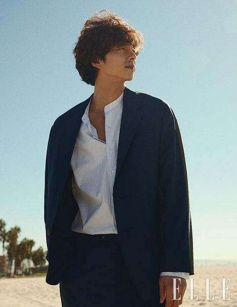 Suit, White, Clothing, Black, Outerwear, Formal wear, Blazer, Standing, White-collar worker, Fashion,
