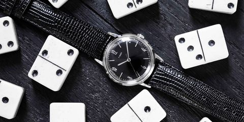 Black, Games, Fashion accessory, Font, Material property, Strap, Watch, Watch accessory, Black-and-white, Rectangle,