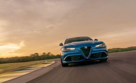 Land vehicle, Vehicle, Car, Automotive design, Sky, Blue, Performance car, Bugatti, Bugatti veyron, Sports car,