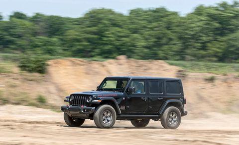 Land vehicle, Vehicle, Car, Automotive tire, Off-roading, Tire, Off-road vehicle, Jeep, Automotive design, Sport utility vehicle,