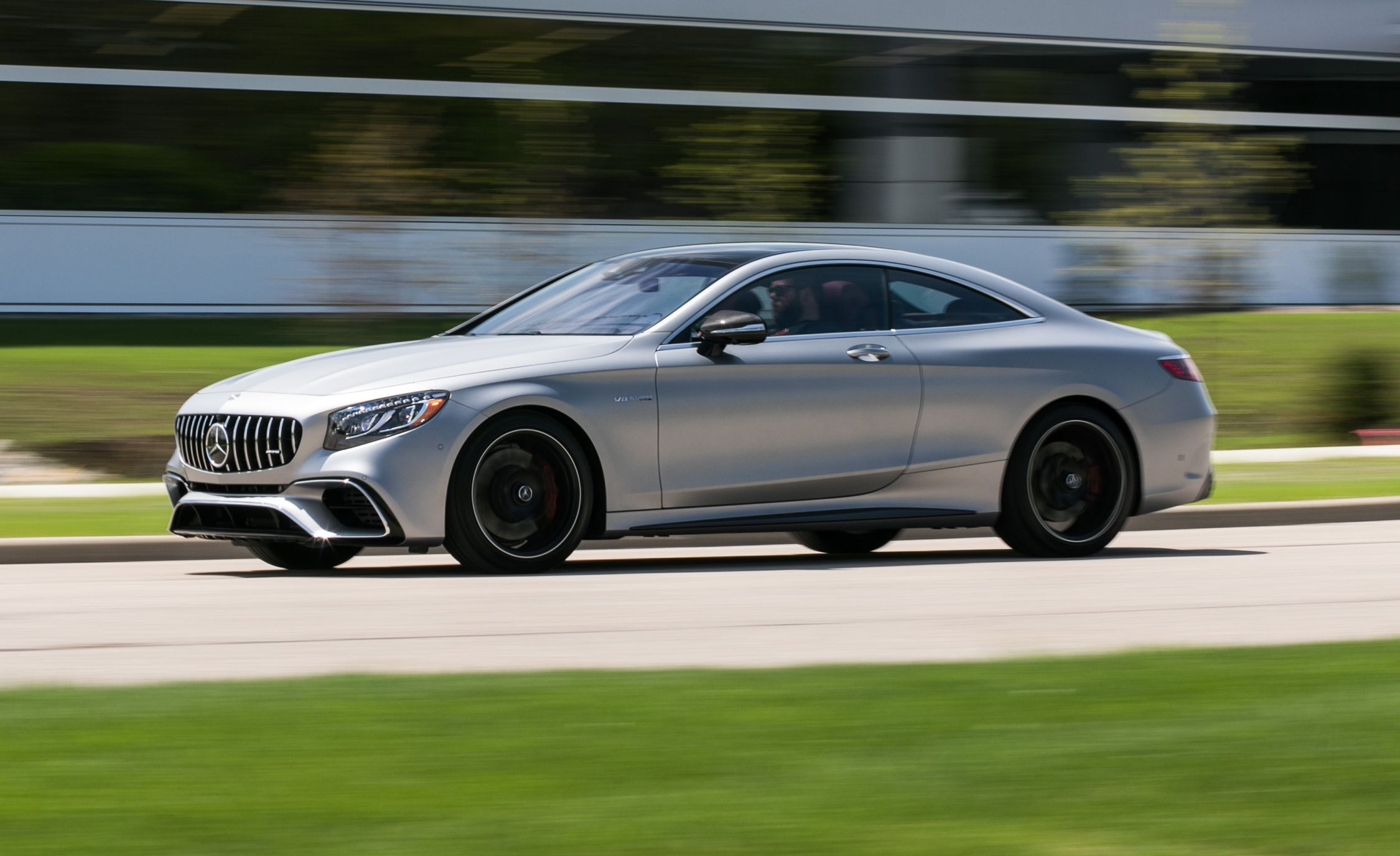 2018 mercedes amg s63 coupe test grand touring review car andchris amoscar and driver civility meets brutality in the mercedes amg s63