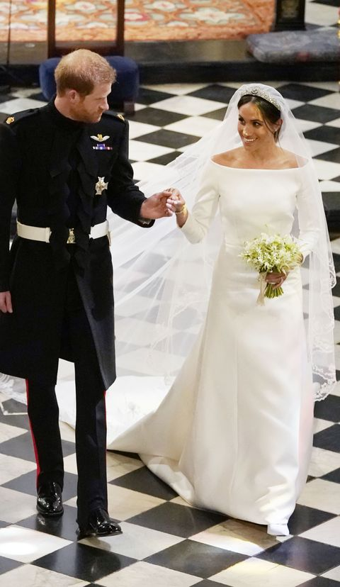 bc6f19b42bd 10 Things You Missed About Meghan Markle s Two Wedding Dresses
