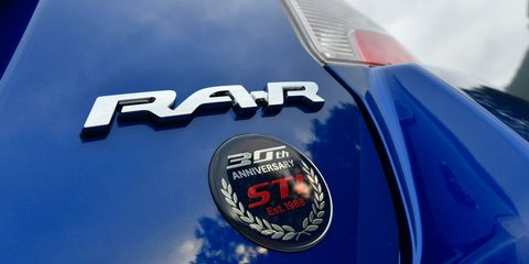 Land vehicle, Vehicle, Car, Automotive design, Emblem, Hood, Electric blue, Logo, Wheel, Symbol,