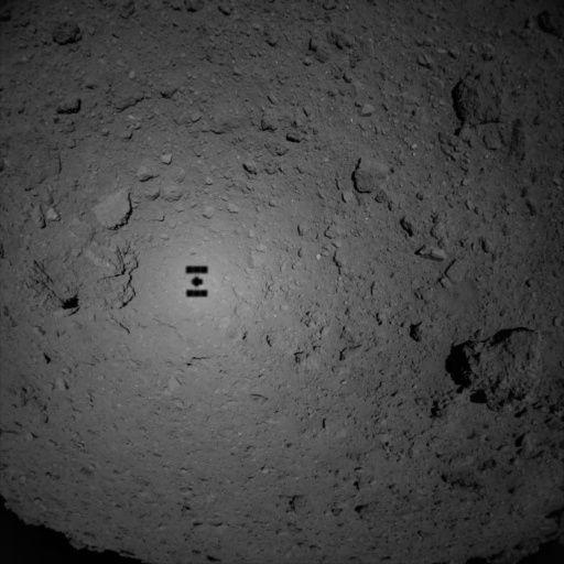 jaxa's hayabusa 2 spacecraft descends upon the asteroid ryugu