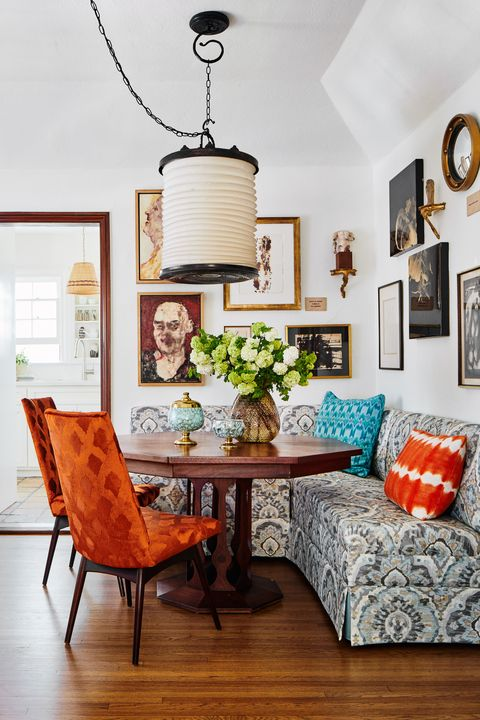 kevin isbell, dining table, orange chairs, blue cushions