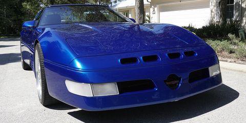 Land vehicle, Vehicle, Car, Hood, Coupé, Sports car, Automotive exterior, Bumper, Performance car, Auto part,
