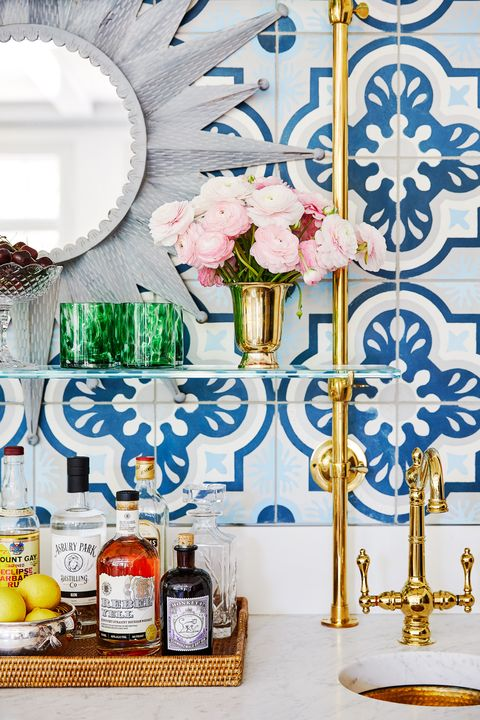 colleen bashaw bar with gold taps and blue and white mosaic tiles