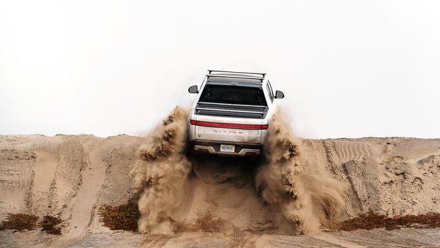 rivian climbing a dune